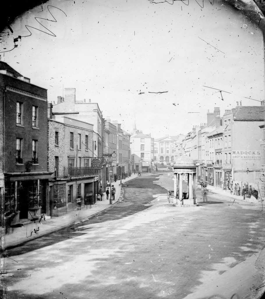 The Spaldings' earliest surviving view of the lower end of Chelmsford High Street, with Shire Hall visible in the distance, probably taken in 1865 (D/F 269/1/3715)