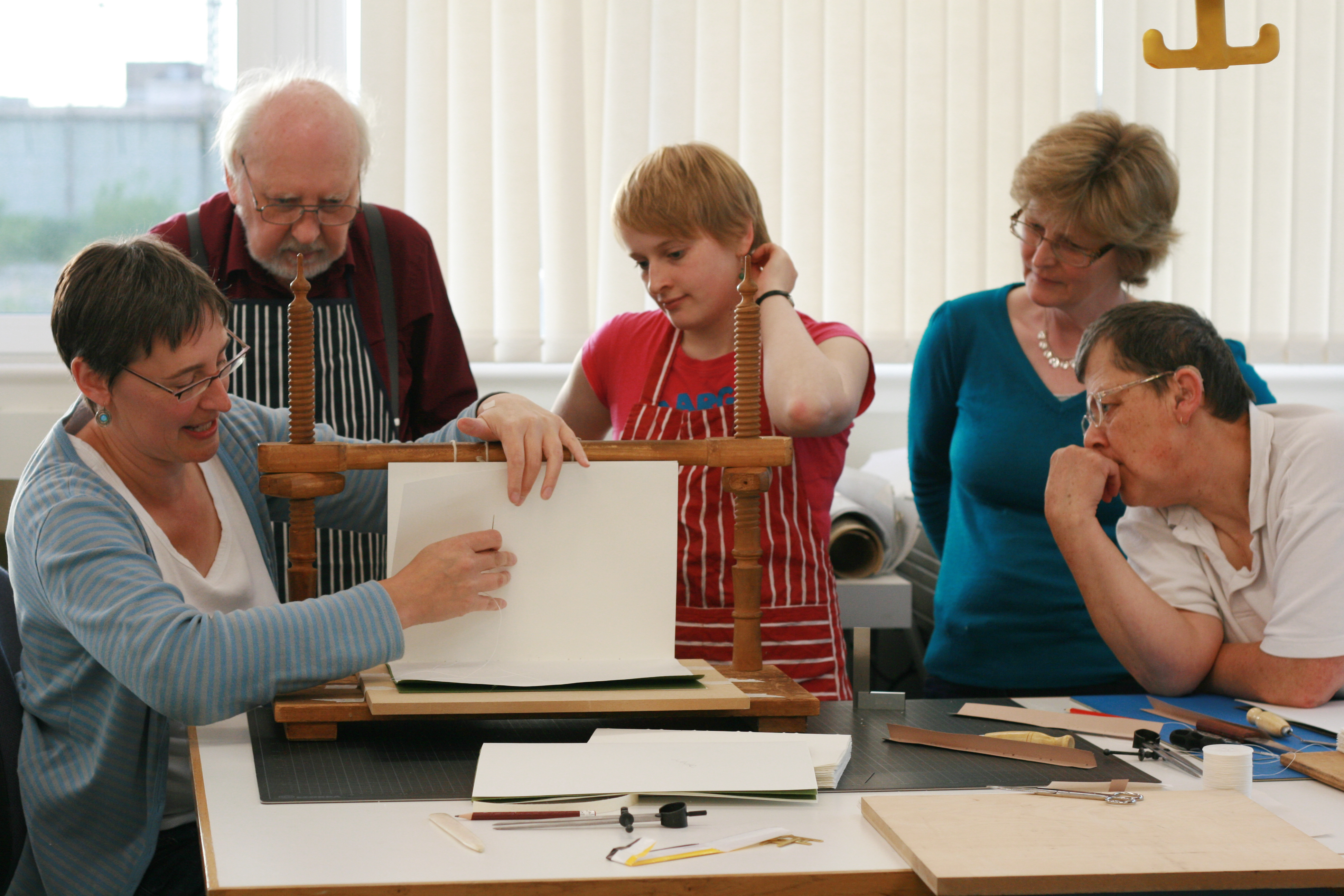 Participants at a bookbinding class