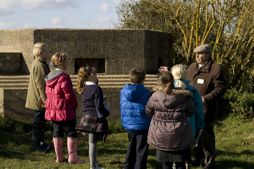 Roger Kennell of the Clacton Victoria County History group tells children about an infantry pillbox