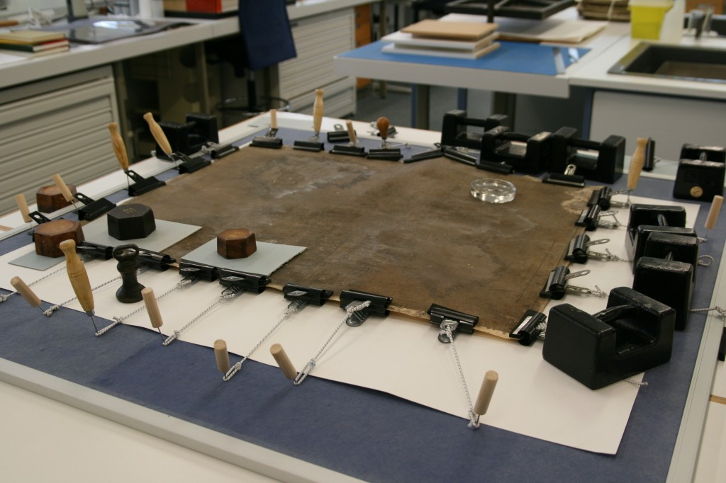 During conservation work. As part of the conservation work the map was stretched out after being humidified. This looks alarming but it mimics the original treatment process the parchment went through when new.