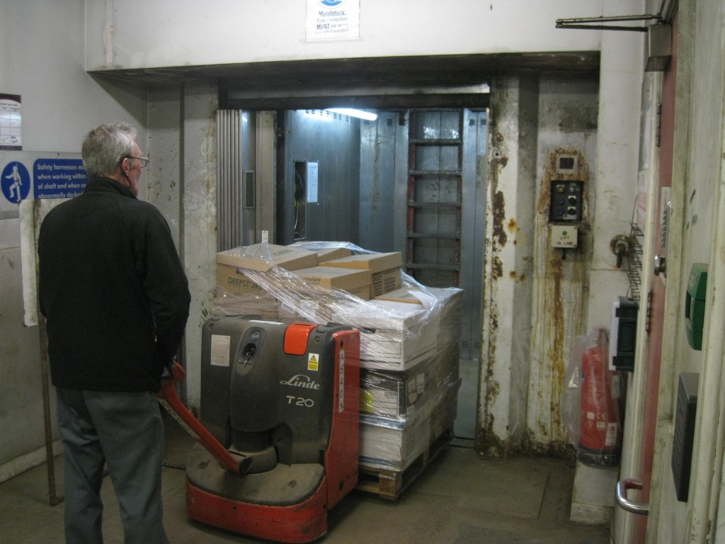 Boxes of documents going into the lift