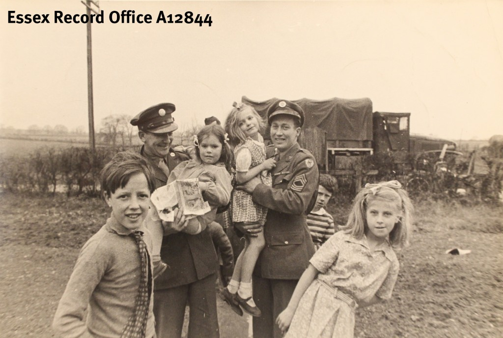 American airmen host a party for local and evacuated children in Lindsell, 1944