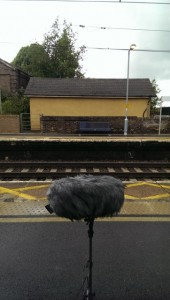 Photograph of platform at Marks Tey station with microphone in the foreground