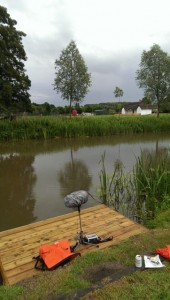 Photograph of River Stour, with microphone in foreground