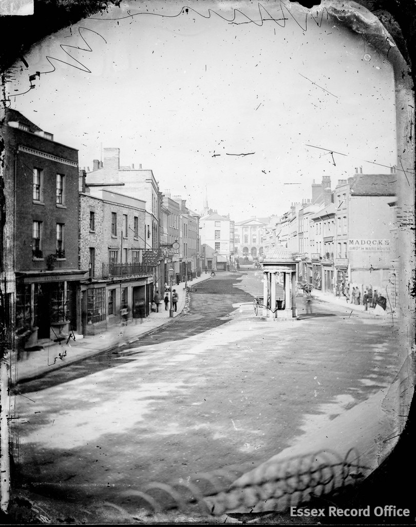 Fred Spalding's earliest surviving view of the lower end of Chelmsford High Street, with Shire Hall visible in the distance, taken in the late 1860s on a glass plate using the wet collodion process. Taking a photograph outdoors using this process was extremely challenging. (D/F 269/1/3715)