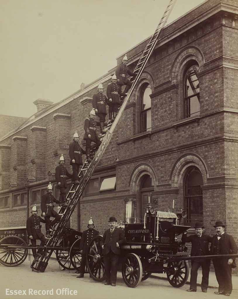Chelmsford Borough Fire Brigade proudly demonstrate their new fire escape ladder against the side of Chelmsford's Corn Exchange, May 1899. Until 1918 the Chelmsford Fire Brigade relied on horses to pull their fire engines. (I/Sp 15/350)