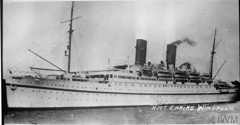 Black and white picture of the Empire Windrush on water