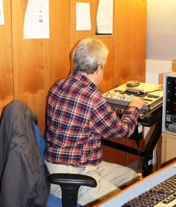 Photograph of volunteer working at tape player